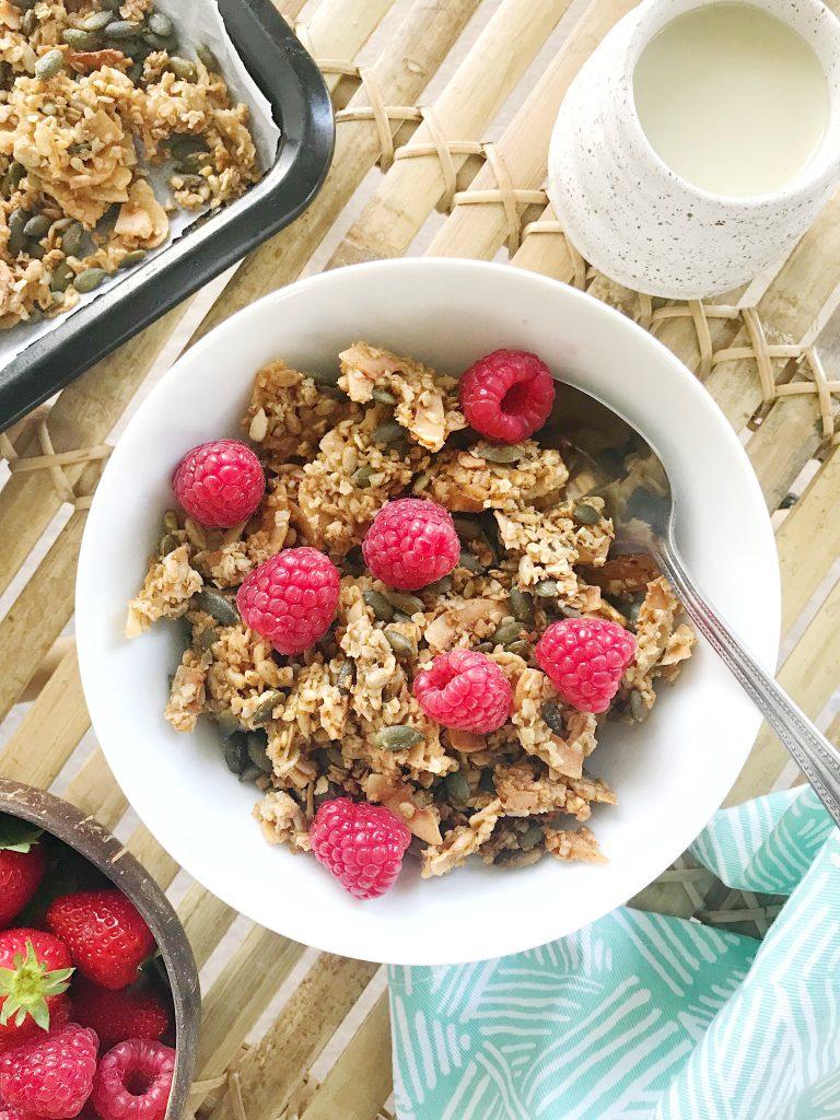 coconut granola recipe with oat milk and raspberries